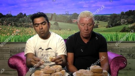 Karthik Nagesan and Derek Acorah have a donut-eating contest in the Diary Room