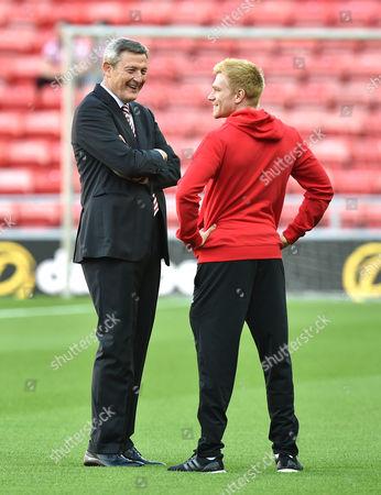 Owener Ellis Short and Duncan Watmore of Sunderland talk on the pitch