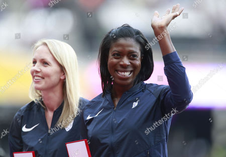 Christine Ohuruogu of Great Britain receives a medal from a previous World Championships that was denied due to a Drug Cheating athlete