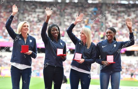 Britain's Lee McConnell, Christine Ohuruogu, Nicola Sanders and Perri Shakes-Drayton, from left, wave after receiving their bronze medals during a ceremony at the World Athletics Championships in London . Britain originally finished fourth in the women's 4x400m relay at the World Championships in Daegu in 2011 but were promoted from fourth to bronze following the disqualification of the results of the original medallists after their sanction for anti-doping rule violations