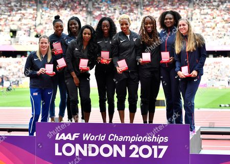 From Left, Britain's silver medal winners Eilidh Doyle, Shana Cox and Christine Ohuruogu, United States' gold medal winners Francena McCorory, Ashley Spencer, Natasha Hastings and Jessica Beard and France's bronze medal winners Muriel Hurtis-Houairi and Marie Gayot pose with their medals during the World Athletics Championships in London . The US originally finished second, Britain third and France fourth in the women's 4x400m relay at the World Championships in Moscow in 2013 but were promoted following the disqualification of the results of the original medallists after their sanction for anti-doping rule violations