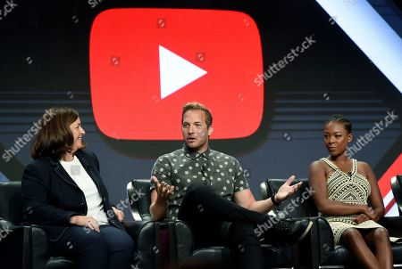 """Ryan Hansen, Samira Wiley, Susanne Daniels Ryan Hansen, center, star of the YouTube Red original series """"Ryan Hansen Solves Crimes on Television,"""" answers a question as YouTube Global Head of Original Content Susanne Daniels, left, and cast member Samira Wiley look on during a panel discussion at the 2017 Television Critics Association Summer Press Tour at the Beverly Hilton, in Beverly Hills, Calif"""