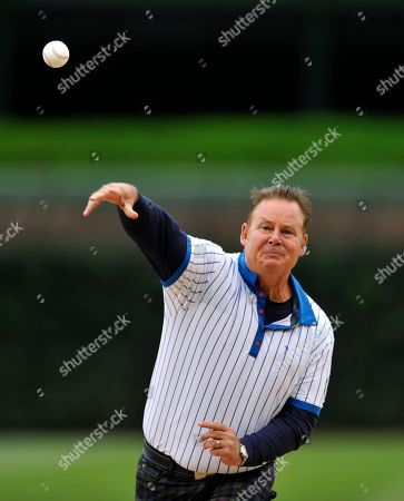 Actor Joel Murray throws out a ceremonial first pitch before a baseball game between the Chicago Cubs and the Washington Nationals, in Chicago