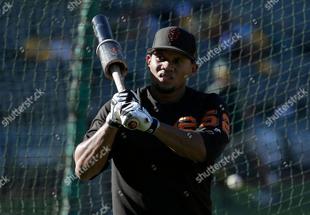 San Francisco Giants third baseman Miguel Gomez (52) before a baseball game against the Oakland Athletics in Oakland, Calif