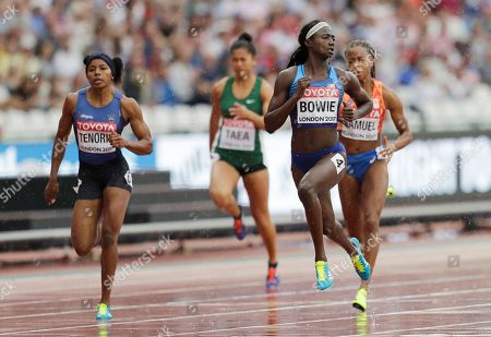 Ecuador's Angela Tenorio, Cook Islands' Patricia Taea, United States' Tori Bowie and Netherlands' Jamile Samuel, from left, compete in a women's 100m heat during the World Athletics Championships in London