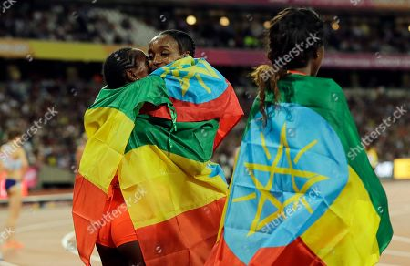 Stock Picture of Ethiopia's Almaz Ayana celebrates with teammate Dera Dida, left, after winning the Women's 10,000 meters final during the World Athletics Championships in London