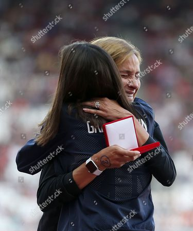 Stock Photo of Kara Goucher of USA and Joanne Pavey of Great Britain are awarded silver and Bronze medals in the Women's 10,000m for Osaka 2007