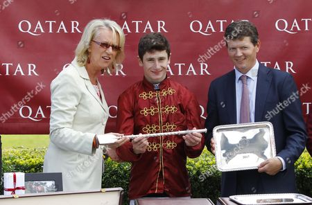 Sally Taylor of BBC South Today presents to Oisin Murphy and Andrew Balding had won the Qatar Stewards Cup Sprint at Goodwood.