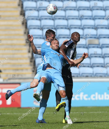 Coventry City's Liam Kelly and  Rod McDonald battle with Notts County's Shola Ameobi
