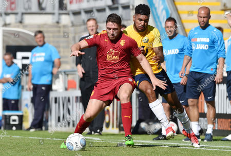 Jamie Reid of Torquay United battles for the ball with Adam Buxton of Tranmere Rovers, Vanarama National League match between Torquay United and Tranmere Rovers on Saturday 5th August 2017 at Plainmoor, Torquay, Devon