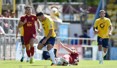 Jake Gosling of Torquay United is tackled from behind by Jeff Hughes of Tranmere Rovers, Vanarama National League match between Torquay United and Tranmere Rovers on Saturday 5th August 2017 at Plainmoor, Torquay, Devon