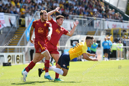 James Norwood of Tranmere Rovers & Oliver Norburn of Tranmere Rovers take down Jake Gosling of Torquay United Vanarama National League match between Torquay United and Tranmere Rovers on Saturday 5th August 2017 at Plainmoor, Torquay, Devon