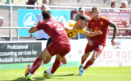 Jake Gosling of Torquay United battles for the ball with Liam Ridehalgh of Tranmere Rovers Vanarama National League match between Torquay United and Tranmere Rovers on Saturday 5th August 2017 at Plainmoor, Torquay, Devon