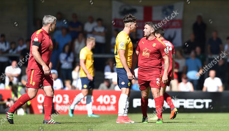Ruairi Keating of Torquay United has a word with Adam Buxton of Tranmere Rovers, Vanarama National League match between Torquay United and Tranmere Rovers on Saturday 5th August 2017 at Plainmoor, Torquay, Devon