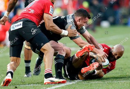 Lions' Lionel Mapoe, right, is tackled by Crusaders' Israel Dagg during the Super Rugby final between South Africa's Lions and New Zealand's Crusaders, at Ellis Park stadium in Johannesburg