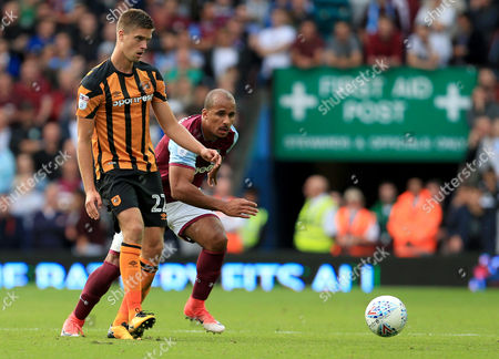 Markus Henriksen of Hull City is chased down by Gabriel Agbonlahor of Aston Villa