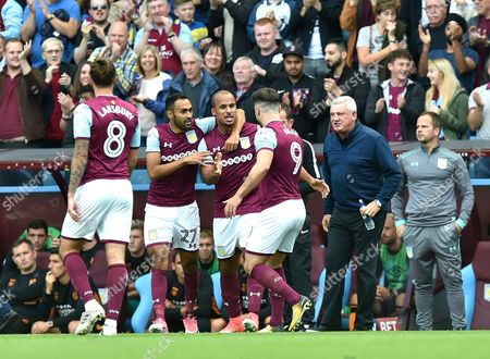 Gabriel Agbonlahor of Aston Villa scores the opening goal 1-0 and celebrates as Manager Steve Bruce of Aston Villa looks on