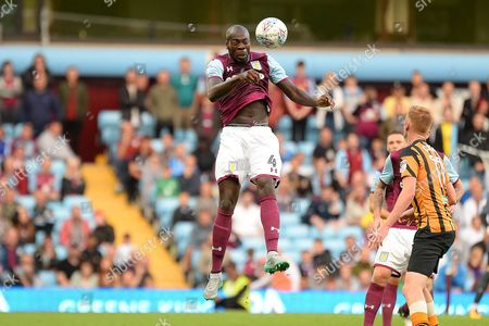 Aston Villa defender Christopher Samba (4) heads the ball during the EFL Sky Bet Championship match between Aston Villa and Hull City at Villa Park, Birmingham