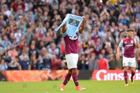 Aston Villa striker Gabriel Agbonlahor (11) scores a goal and celebrates holding a t shirt in support of carl ikeme during the EFL Sky Bet Championship match between Aston Villa and Hull City at Villa Park, Birmingham