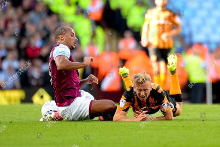 Hull City striker Jarrod Bowen (20) is tackled by Aston Villa striker Gabriel Agbonlahor (11) during the EFL Sky Bet Championship match between Aston Villa and Hull City at Villa Park, Birmingham