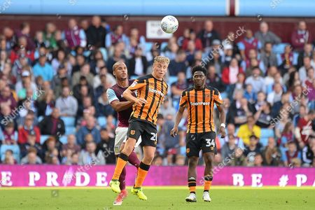 Hull City striker Jarrod Bowen (20) heads the ball under pressure from Aston Villa striker Gabriel Agbonlahor (11) during the EFL Sky Bet Championship match between Aston Villa and Hull City at Villa Park, Birmingham