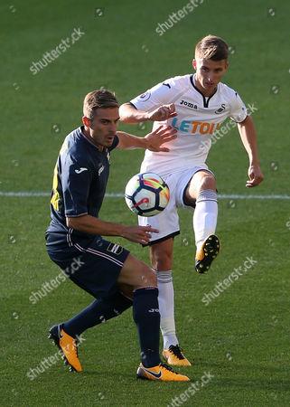 Tom Carroll of Swansea passes the ball past Valerio Verre of Sampdoria.