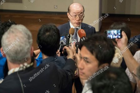 Chinese Ambassador to the United Nations Liu Jieyi speaks to reporters after a Security Council vote on a new sanctions resolution that would increase economic pressure on North Korea to return to negotiations on its missile program, at U.N. headquarters
