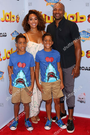 """Stock Photo of Derek Fisher, Gloria Govan, Isaiah Barnes, Carter Barnes Gloria Govan, left, Derek Fisher and twins Isaiah and Carter Barnes arrive at the LA Premiere of """"The Nut Job 2: Nutty by Nature"""", in Los Angeles"""