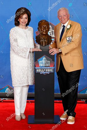 Jerry Jones, Gene Jones NFL team owner Jerry Jones, right, poses with his wife and presenter, Gene Jones, next to a bust of him during inductions at the Pro Football Hall of Fame, in Canton, Ohio