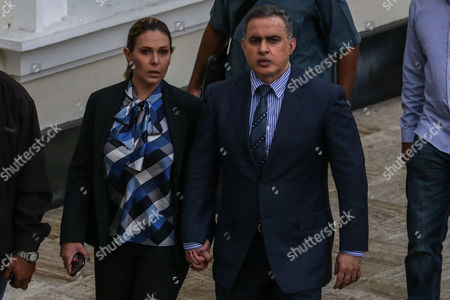 Venezuela's new Attorney General Tarek William Saab Halabi (R) walks next to his wife Carla Di Martino (L) in Caracas, Venezuela, 05 August 2017. Saab Halabi said on 05 August that the removal of his predecessor Luisa Ortega Diaz restores the 'severely infringed legal order' in the country, while defending the decision that appointed him in office because it is in compliance with 'legality'.