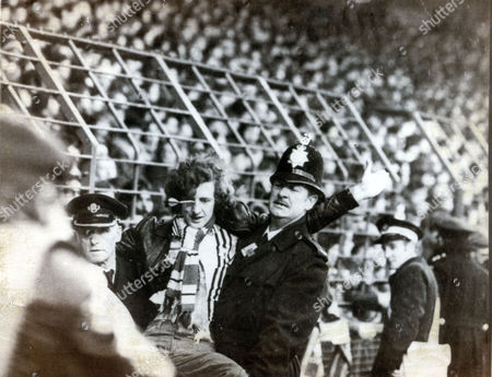 Peter Brookes Is Carried Away By The Police After Getting A Dart In His Eye During The Liverpool V Manchester United Match In February 1978.