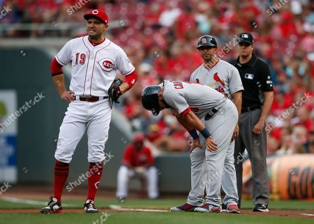 Matt Carpenter, Joey Votto St. Louis Cardinals' Matt Carpenter, front right, composes himself at first base after being hit by a pitch by Cincinnati Reds starter Luis Castillo during the first inning of a baseball game, in Cincinnati. Reds' Joey Votto, left, looks on