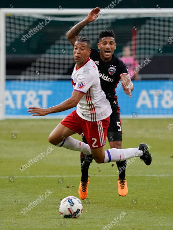 Justin Morrow, Sean Franklin Toronto FC defender Justin Morrow (2) and D.C. United defender Sean Franklin (5) vie for control of the ball during the first half of an MLS soccer match, in Washington