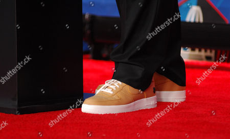 Stock Image of Jerry Jones custom Nike Air shoes made by Phil Knight to match his gold jacket during the Pro Football Hall of Fame Enshrinement at Tom Benson stadium in Canton, OH
