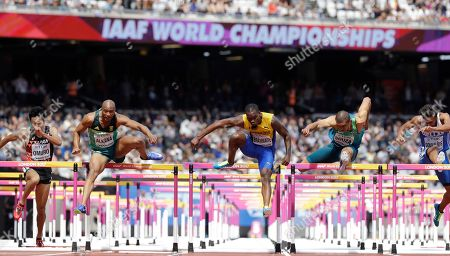 Japan's Hideki Omuro, South Africa's Antonio Alkana, Barbados' Shane Brathwaite, Brazil's Eder Antonio Souza and Greece's Konstadinos Douvalidis, from left, compete in a men's 110-meter hurdles first round heat during the World Athletics Championships in London