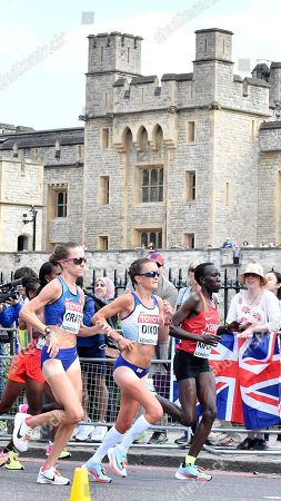 United States' Amy Cragg, Britain's Alyson Dixon and Kenya's Edna Kiplagat, from left, they pass by the Tower of London during the women's marathon of the World Athletics Championships in London