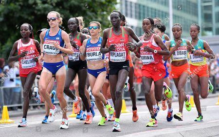 Bahrain's gold medal winner Rose Chelimo, United States' bronze medal winner Amy Cragg, United States' Serena Burla and Kenya's silver medal winner Edna Kiplagat, from left, compete in the women's marathon during the World Athletics Championships in London