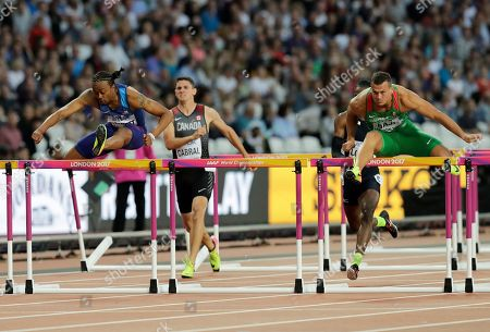 United States' Aries Merritt, left, and Hungary's Balazs Baji, right, compete in a Men's 110 meters hurdles semifinal during the World Athletics Championships in London