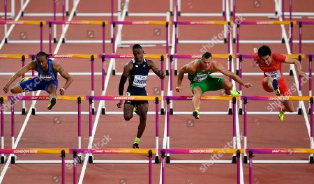 Men's 110 meters hurdles semifinalist's from left, United States' Aries Merritt, US Virgin Islands's Eddie Lovett, Hungary's Balazs Baji and China's Xie Wenjun race during the World Athletics Championships in London