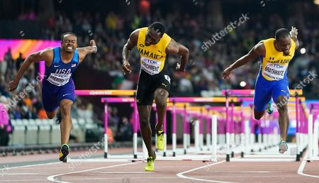 United States' Aries Merritt, Jamaica's Hansle Parchment and Barbados' Shane Brathwaite dip for the line in the final of the Men's 110m hurdles during the World Athletics Championships in London