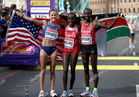 (Left to right) Amy Cragg of USA, Rose Chelimo of Bahrain and Edna Kiplagat of Kenya poses after the Women's Marathon final