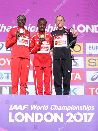 (Left to right) Edna Kiplagat of Kenya, Rose Chelimo of Bahrain and Amy Cragg of USA poses during the Women's Marathon medal ceremonies
