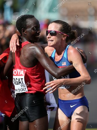 Stock Photo of Amy Cragg of USA hugs Edna Kiplagat of Kenya after the Women's Marathon
