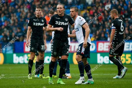 Leeds United defender Luke Ayling (2) is picked up at a corner by Bolton Wanderers defender Andy Taylor (3)  during the EFL Sky Bet Championship match between Bolton Wanderers and Leeds United at the Macron Stadium, Bolton