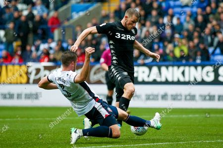 Leeds United forward Chris Wood (9) is stopped by Bolton Wanderers defender Andy Taylor (3)  during the EFL Sky Bet Championship match between Bolton Wanderers and Leeds United at the Macron Stadium, Bolton