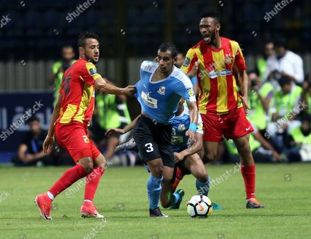 Esperance de Tunis player Fousseny Coulibaly (R) and Ghailene Chaalali (L), Al-Faisaly player Ibrahim Daldoom (C) in action during the Arab Club Championship final match between Al-Faisaly vs Esperance de Tunis at Alexandria Stadium in Alexandria, Egypt, 06 August 2017.