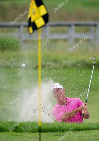 Stock Picture of MNJA101 Corey Pavin work his way out of a sand trap on the 3rd hole during the Championship Round of the 3M golf tournament at TPC Twin Cities on in Blaine, Minn
