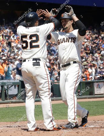 Jarrett Parker, Miguel Gomez San Francisco Giants' Jarrett Parker, right, celebrates after hitting a two-run home run that scored Miguel Gomez (52) against the Arizona Diamondbacks during the second inning of a baseball game in San Francisco