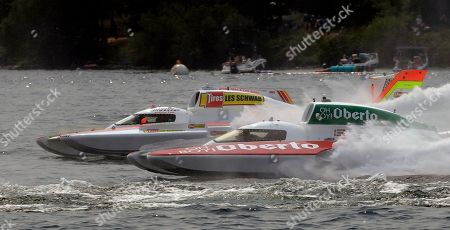 Andrew Tate, left, driving the Les Schwab Tires boat, races against JW Myers, driving the Oh Boy! Oberto boat, during a heat of the H1 Unlimited Albert Lee Appliance Cup during Seafair weekend, in Seattle