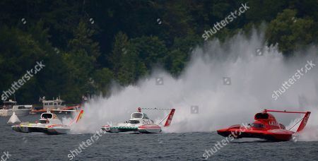 From left to right, Andrew Tate, driving the Les Schwab Tires boat, JW Myers, driving the Oh Boy! Oberto boat, and J. Michael Kelly, driving the Graham Trucking boat, race during a heat of the H1 Unlimited Albert Lee Appliance Cup during Seafair weekend, in Seattle
